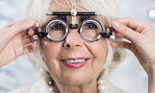 Senior woman in optician's office having examined sight